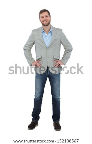 Stylish man smiling with hands on hips looking at camera on white background - stock photo