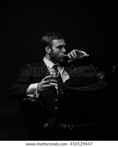 Stylish man with the hat and beard  black and white portrait - stock photo