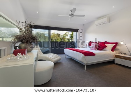 Stylish master bedroom in luxury Australian mansion - stock photo