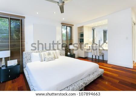 Stylish master bedroom in luxury home - stock photo