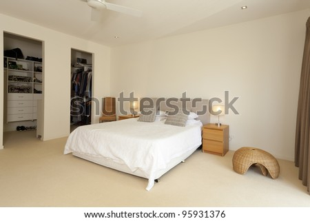 Stylish master bedroom with walk in closet - stock photo