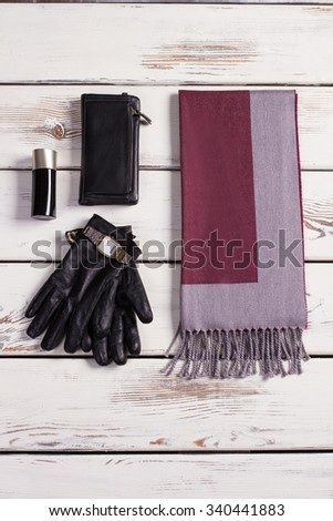 Stylish men's accessories on a white wooden background. Shop of business wear. - stock photo