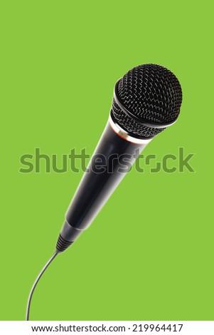 Stylish microphone isolated on green background for chroma key - stock photo