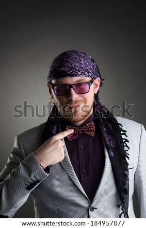 Stylish middle-aged showman posing at camera - stock photo