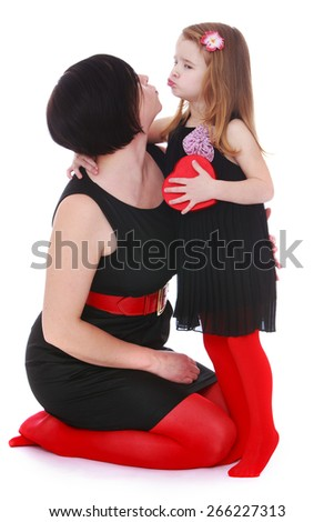 Stylish Mom and daughter kissing. - isolated on white background - stock photo