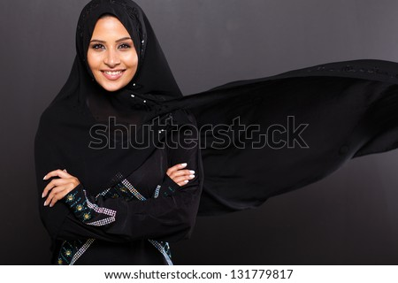 stylish Muslim woman on black background - stock photo
