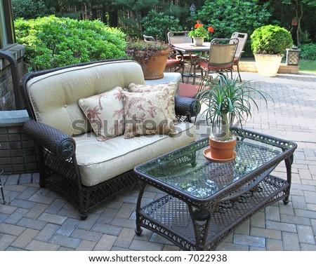 Stylish patio with furnishings - stock photo