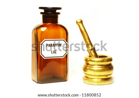 Stylish pharmacy bottle and mortar, isolated - stock photo