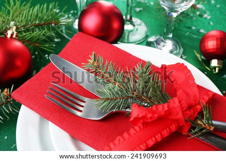Stylish red, green and white Christmas table setting  - stock photo