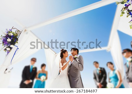 stylish rich asian bride and groom dancing first wedding dance in island Santorini greece sunshine - stock photo
