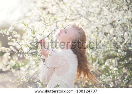 Stylish shot of beautiful blonde Spring Park - stock photo