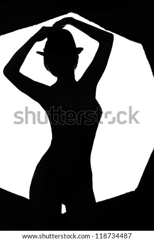 stylish silhouette beautiful woman dancing cabaret isolated white background - stock photo