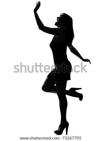 stylish silhouette caucasian beautiful woman dancing happy fun full length on studio isolated white background - stock photo