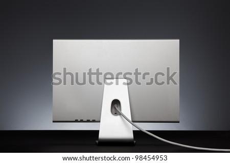 Stylish silver monitor. Rear view - stock photo