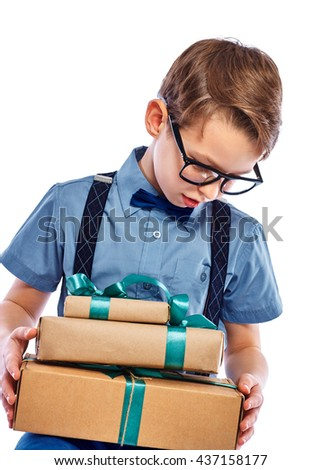 Stylish small boy in glasses received a gift. Isolated on a white background. - stock photo