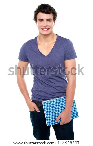 Stylish teenager posing casually in denims isolated against white background - stock photo