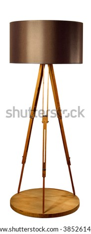 Stylish tripod lamp, made own from an old tripod and wood debris. - stock photo