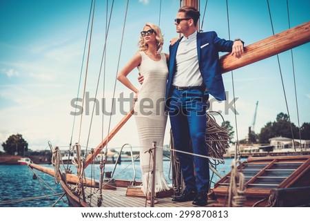 Stylish wealthy couple on a luxury yacht  - stock photo