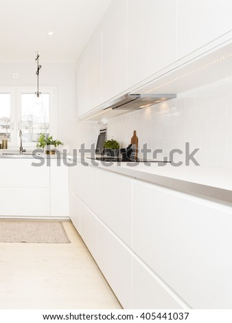 stylish white kitchen counter  - stock photo