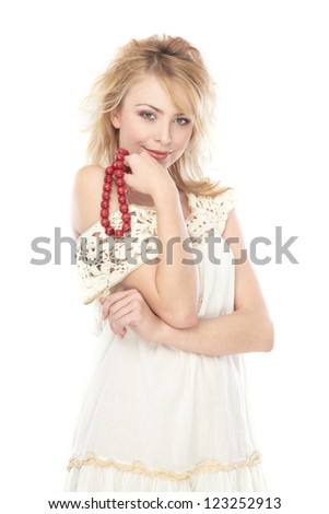 Stylish woman holds red beads on a white background - stock photo