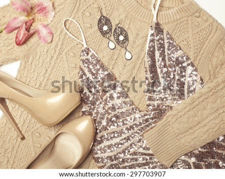 Stylish woman outfit in beige colors on white background - stock photo