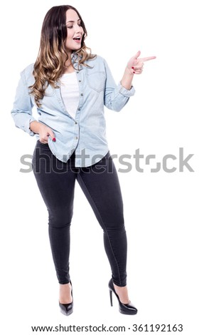 Stylish woman pointing her index finger at something - stock photo