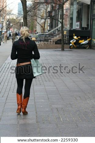 stylish woman walking down street - stock photo