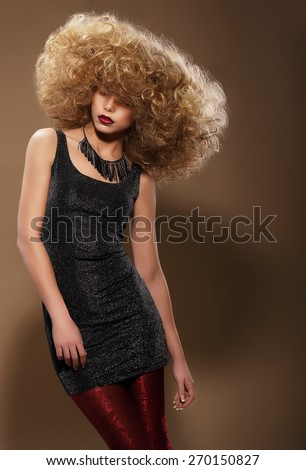 Stylish Woman with Extravagant Hairstyle. Vogue  - stock photo