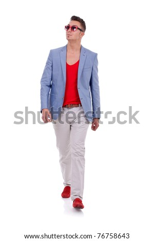 Stylish young man walking on white background - stock photo
