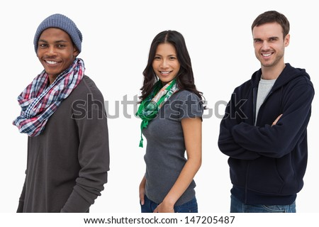 Stylish young people in a row looking happy on white background - stock photo