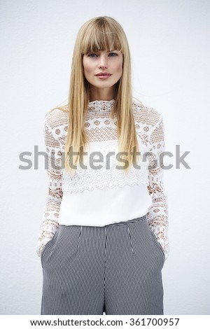 Stylish young woman in culottes against white background - stock photo