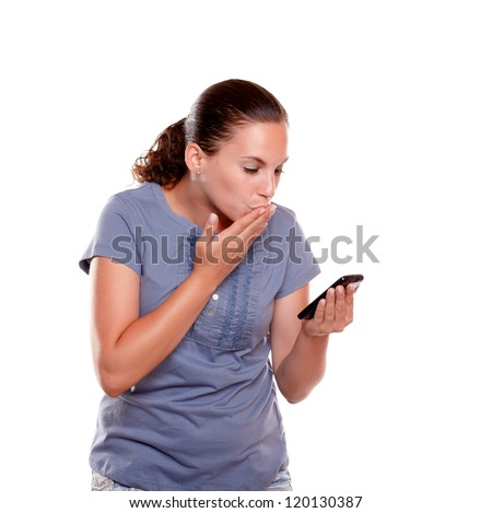 Stylish young woman sending a kiss by cellphone on blue shirt standing over white background - stock photo
