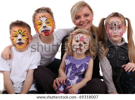 stylist painted kids faces of animals - stock photo