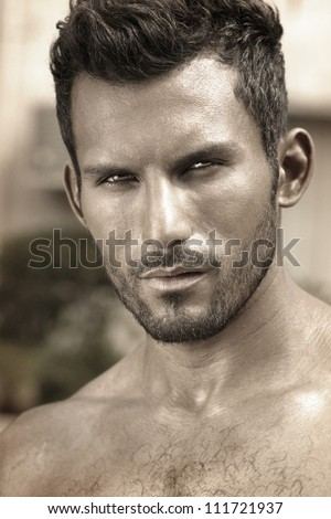 Stylized close detailed portrait of masculine handsome young man in sepia tones - stock photo