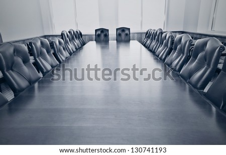 Stylized photo of an empty conference room - stock photo