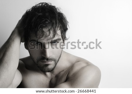 Stylized portrait of masculine attractive young shirtless man with beard against white background - stock photo