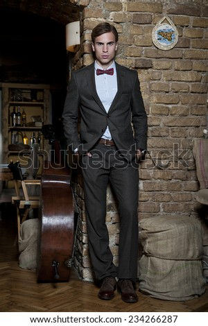 Stylized portrait of masculine handsome young man against neutral background - stock photo