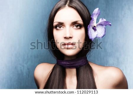 stylized woman portrait with orchid studio shot - stock photo