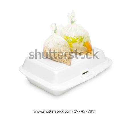 Styrofoam box with food in plastic bag isolated on white background - stock photo