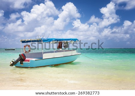 sub charter boat on the sea in mautitius tropical island - stock photo