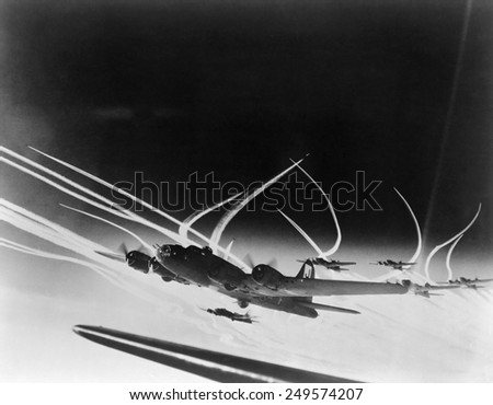 Sub-stratospheric Vapor trails of B-17 Flying Fortresses of the U.S. Army 8th Air Force. The curved trails were made by fighters accompanying the B-17s.Ca. 1944. - stock photo