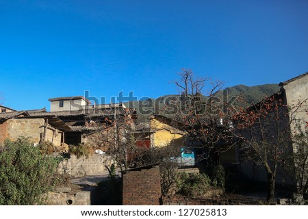 sub-urban farmhouse with fruit trees in Kunming, China - stock photo