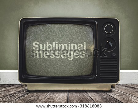 subliminal messages in the media - stock photo