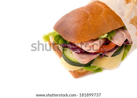 Submarine stuffed sandwich with ham and cheese isolated on white background  - stock photo