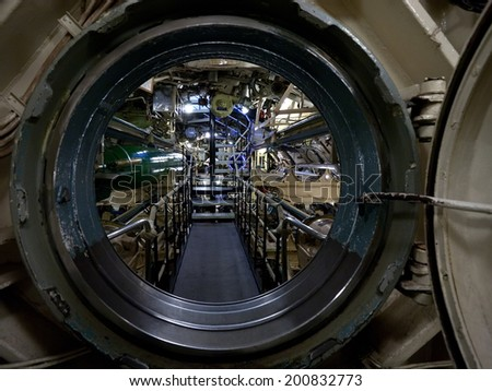 submarine view through manhole, interior with devices and technical equipment - stock photo