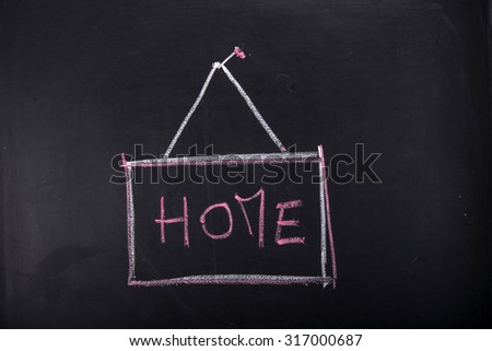 Submission of written home, with chalk on blackboard - stock photo