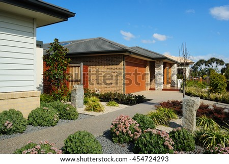 Suburban australian street in new housing estate, Melbourne, Australia - stock photo