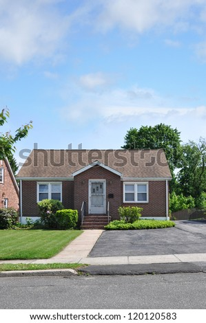Suburban Bungalow Cottage Home Sunny Blue Sky Day - stock photo