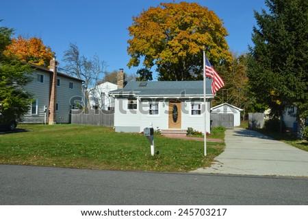Suburban bungalow home sunny autumn clear blue sky day residential neighborhood USA - stock photo