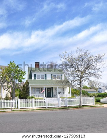 Suburban Cottage Home White Picket Fence American Flag - stock photo